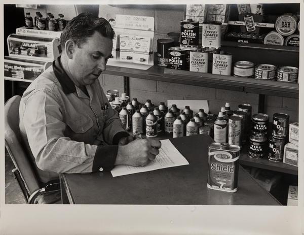 Dupont corporate communication photograph, chemist with Shield, horizontal