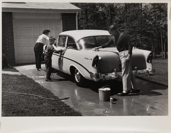Dupont corporate communication photograph, Family washing a car