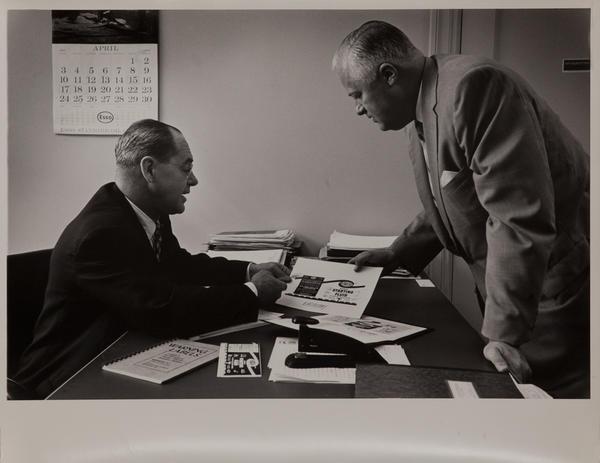 Dupont corporate communication photograph, executives discuss marketing plan