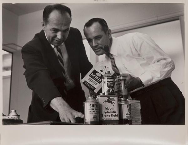 Dupont corporate communication photograph, 2 execs with product, horizontal