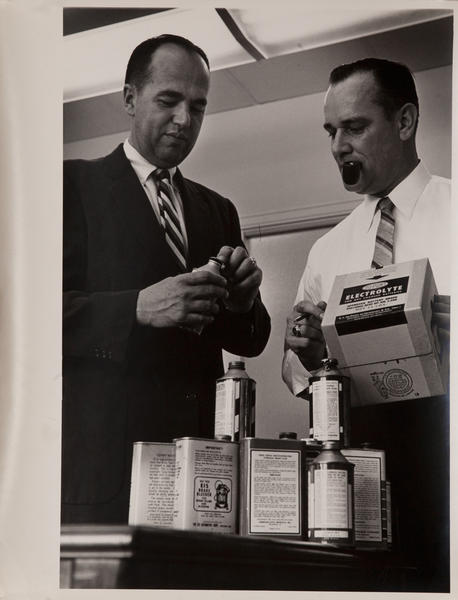 Dupont corporate communication photograph, 2 execs with product, vertical