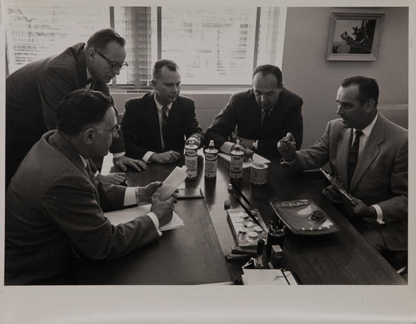 Dupont corporate communication photograph, group of executives with auto products
